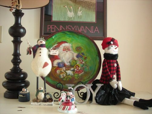 I painted the Santa plate.  Danny got me the little snowmen candle holder.  I love the little snow girl